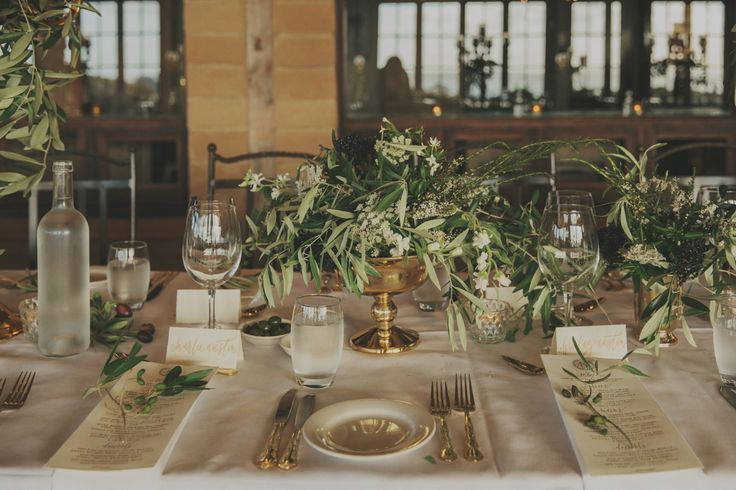Table centrepieces and brassware by Blush floral stylist. blush.co.nz Mud brick cafe Waiheke Island Auckland Wedding. Danelle Bohane photography