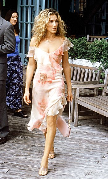 "3. The ""He Loves Me, He Loves Me Not"" Dress- when Carrie fell into the lake with Big in Season 3 wearing this Richard Tyler dress. ""Richard made two of those dresses for us in less than two weeks time!"" She paired it with a Louis Vuitton handbag and vintage shoes. ""Those clear vintage shoes were so beautiful with little rhinestones pressed into the plastic, and that bag was a total church lady bag!"""