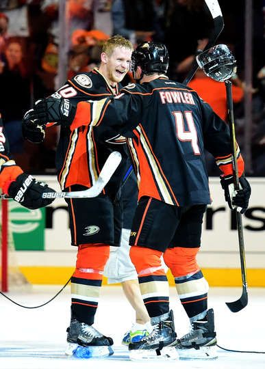 Corey Perry 10 of the Anaheim Ducks celebrates his goal for a 4-3 win over the Edmonton Oilers with Cam Fowler 4 during the second overtime in Game Five