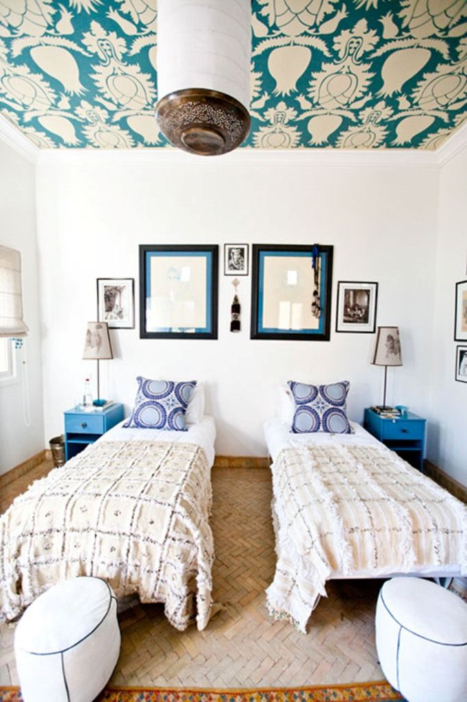 Smart idea: put wallpaper on the ceiling and instantly transform a boxy space into something chic.