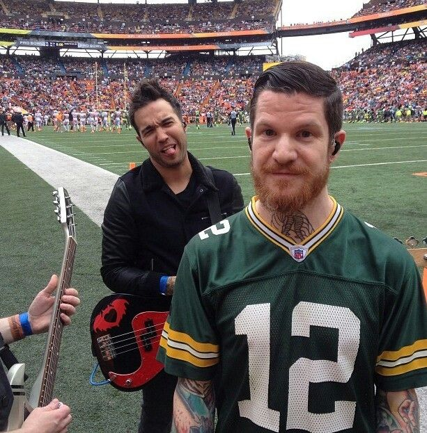 Pete Wentz and Andy Hurley. Pete's face tho :) <3