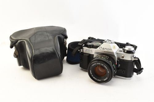 Canon AE-1 Program 35mm Film Camera with FD 50mm f1.8 Prime Lens Strap Case