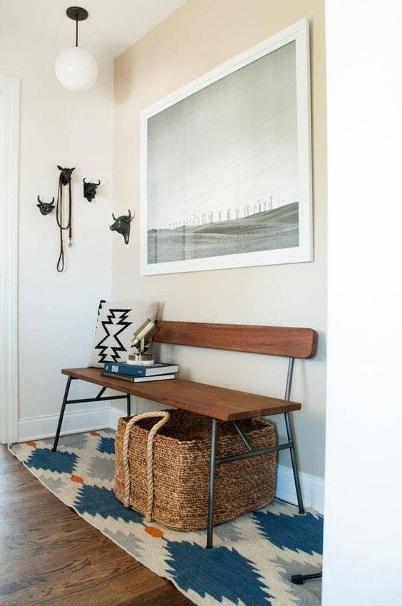 Between jackets, purses, mail and an ever-growing mountain of shoes, the entryway is a tough spot to keep under control—and less square footage unfortunately means even more mayhem. If creating a mudroom or an entryway with built-in storage is not in your floor plan future, follow the tips and tricks tucked into these eight small rooms to make your foyer a calm, fuss-free zone.