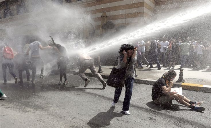 Turkish riot police use water cannons to disperse demonstrators during a protest against the planned construction of a new shopping mall at Taksim Square in Istanbul, Turkey, on May 31, 2013. Protesting under the slogan OccupyGezi, activists have been staging a demonstration since May 28 to save Taksim Square.