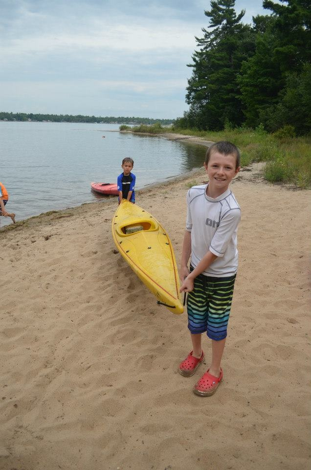 Learning how to Kayak at summer camp