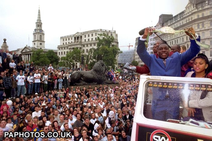 Britain's world heavyweight champion Frank Bruno, with his daughter Rachel, parades his WBC belt he won after an epic battle with Oliver McCall a week ago at Wembley. The open-topped bus paraded Frank and his family from Marble Arch to Trafalgar Square during a parade organised by satellite channel Sky Sports dubbed VB Day - Victory for Bruno Day. 1995