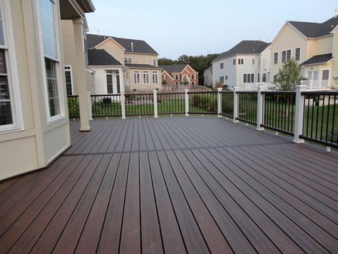 Deck color - Cordovan Brown Semi-Transparent Stain by Behr - I'm liking the wood grain peeking through the dark color to add some interest to the color. Also love the light railing for contrast.