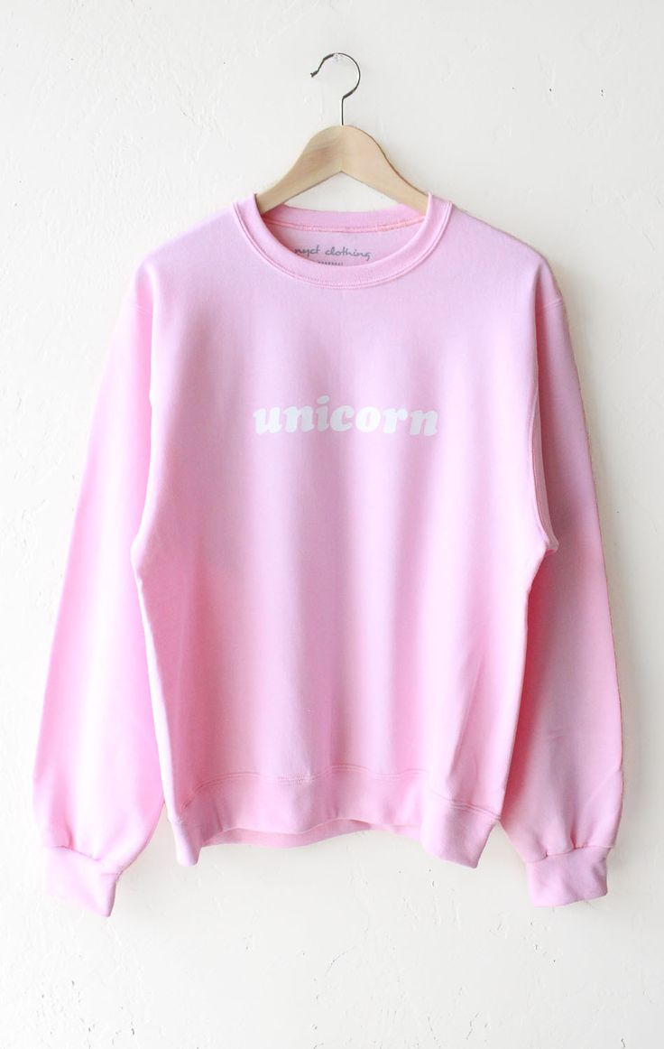 """- Description Details: 'Unicorn' oversized sweater in pink. Brand: NYCT Clothing. Unisex/Oversized fit Measurements: (Size Guide) XS/S: 40"""" bust, 25"""" length, 24.5"""" sleeve length M/L: 44"""" bust, 26"""" len"""