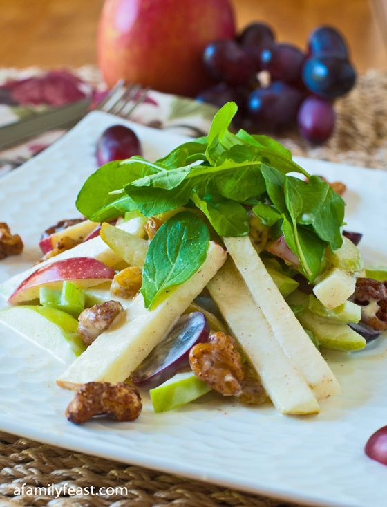 Waldorf Salad - A delicious salad with apples, pears, walnuts, celery, raisins in a sweet and creamy dressing with hints of cinnamon, orange and lemon.  So good!