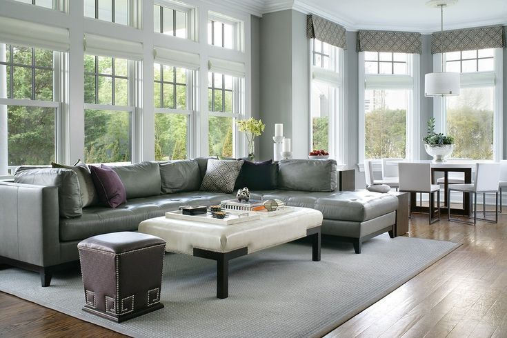 Round Leather Ottoman Family Room Contemporary with Roman Shade Rectangular Area Rugs