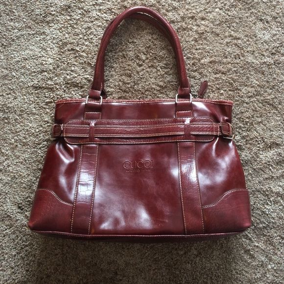 Maroon colored bag Price reflect authenticity! This is still a pretty bag! Few imperfections that I tried to get in picture! I will take more if you'd like! Not going to lie! It's not the best made. It has its flaws. I bought it in the Bahamas. Gucci Bags