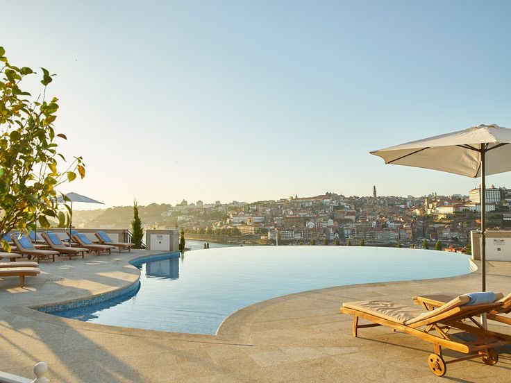 Built on a hillside overlooking Vila Nova de Gaia (where most of the old-line port merchants are located) and the Douro River, the luxurious 82-room hotel gets its identity from the local wine trade. The genteel decor takes its cues from the quintas (farms) of local wine grandees, and each room features photographs and accessories contributed by a different Portuguese winemaker. If the low roofline of the six-story building is also inspired by the local architectural vernacular, it stands…