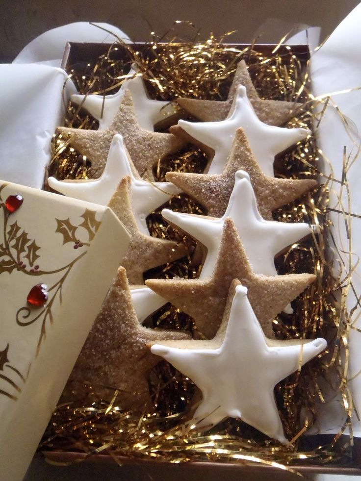 ~Cinnamon Star Cookies lined up in a cute box and nestled in gold shredded paper. A lovely homemade gift!