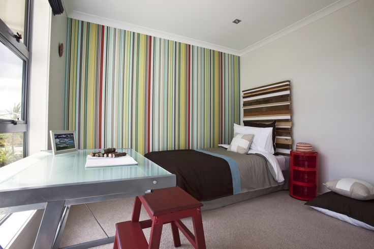 Candy stripe feature wall for the kids, balanced by a natural headboard for the bed.
