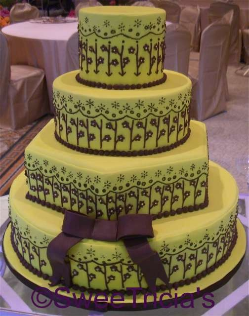 pale lime green cake decorated with chocolate accent flowers