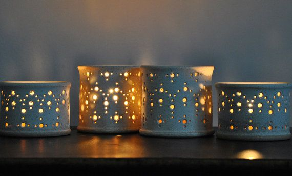 "Twinkling candlelight in exquisite geometric patterns evokes the spacious, light-filled rooms and intricate detail of a Moorish palace. The ""Alhambra"" luminary, $34.00 - $36.00 at naomianita.etsy.com"