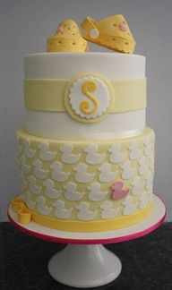 Baby shower cake with ducks and baby Crocs - super cute! For Alison Scott,,,,look it already has the letter S on it :)