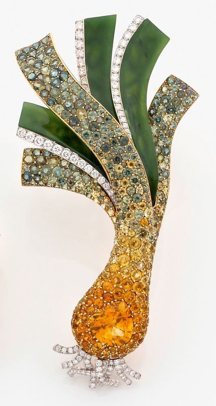 A diamond, sapphire, jade and 18K gold brooch by Lorenz Bäumer. A bejeweled scallion? yes! A reverse edible art almost.