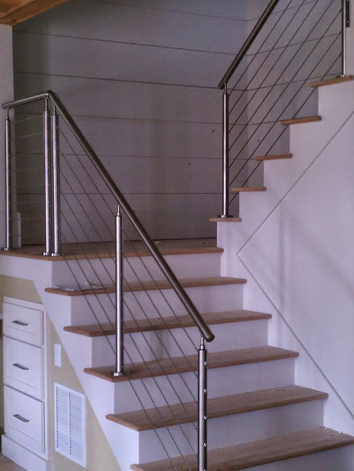 Our stainless steel cable railing system with steel tube posts and handrail