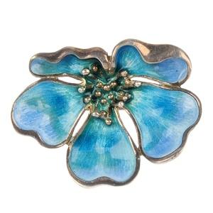A silver enamel floral brooch by Norman Grant