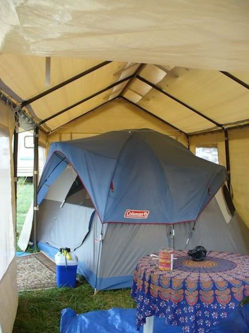 Smart! A tent under a canopy. Additional space is used for living space.