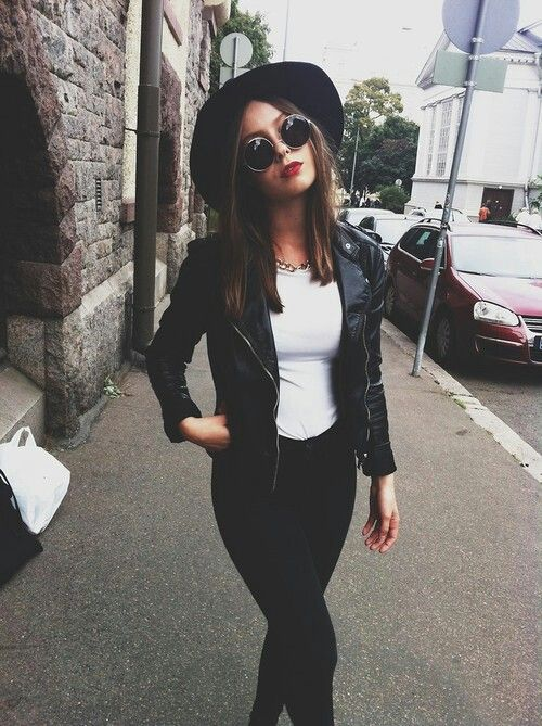 Rock/edgy outfit.black and white simple, casual outfit. Hat.sunglasses.leather jacket