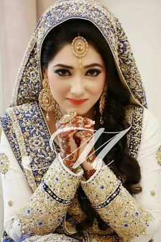 ♡Pakistan Bride - Gorgeous | love the sleeves | blue and white bridal dress for a nikah or walima | great pose for bridal shoot to show the mehndi and jewelry | Pakistani weddings