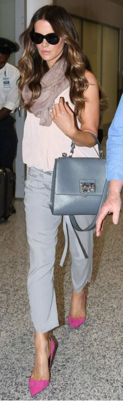 Who made  Kate Beckinsale's gray handbag, tie pants, black sunglasses, and pink suede pumps