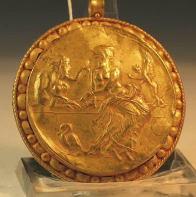Huge Roman Gold pendant decorated with Nymph and Satyr. Circa 2nd century AD.  Ex private London collection, purchased before 1950. Most likely southern Italy.  It is hard to describe just how large and stunning this pendant is.  It will surely make an impact if worn today as it did 2,000 years ago.  Suspension hoop is intact so it is perfectly wearable.