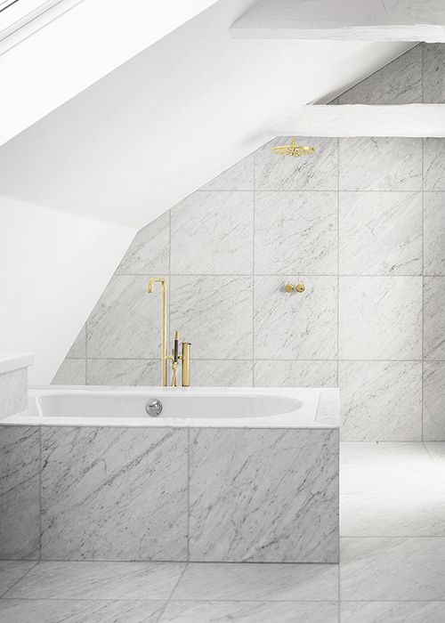 White marble tile with brass hardware, clean & beautiful