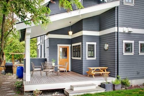 I like the exterior paint colors - blue-grey house with orange-yellow door.