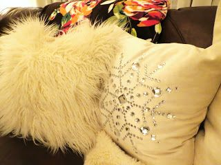 Snowflake inspired embellished satin pillow.