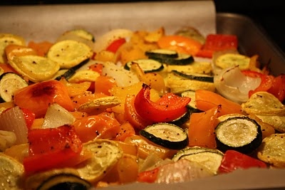 Roasted Vegetables:  1/2 each - red, yellow, & orange peppers  2 medium yellow squash  2 medium zucchini  1 large Vidalia onion  Slice/cut into chunks veggies and put in gallon Ziploc bag.  Pour in 3 T. olive oil.  Add 2 tsp. kosher salt & 2 tsp. black pepper.  Seal bag and toss until veggies well-coated.  Place on cookie sheet lined with parchment paper in 400 degree preheated oven for approx. 25-30 min.  Enjoy a delicious and healthy side with NO dishes to wash...Hooray!
