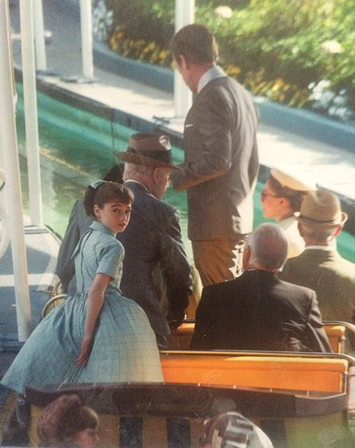 Athena (Raffey Cassidy) with Nix (Hugh Laurie) in the background getting on the It's a Small World Ride display at the 1964 World Fair from Disney Tomorrowland.