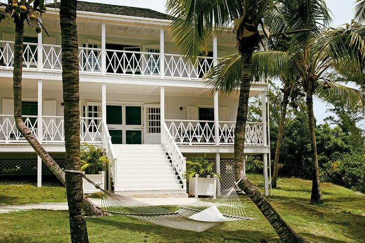 A hammock sits outside the Guest House of India Hick's Harbour Island home