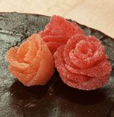 Create edible roses out of gumdrops for an easy yet elegant way to decorate your cake.