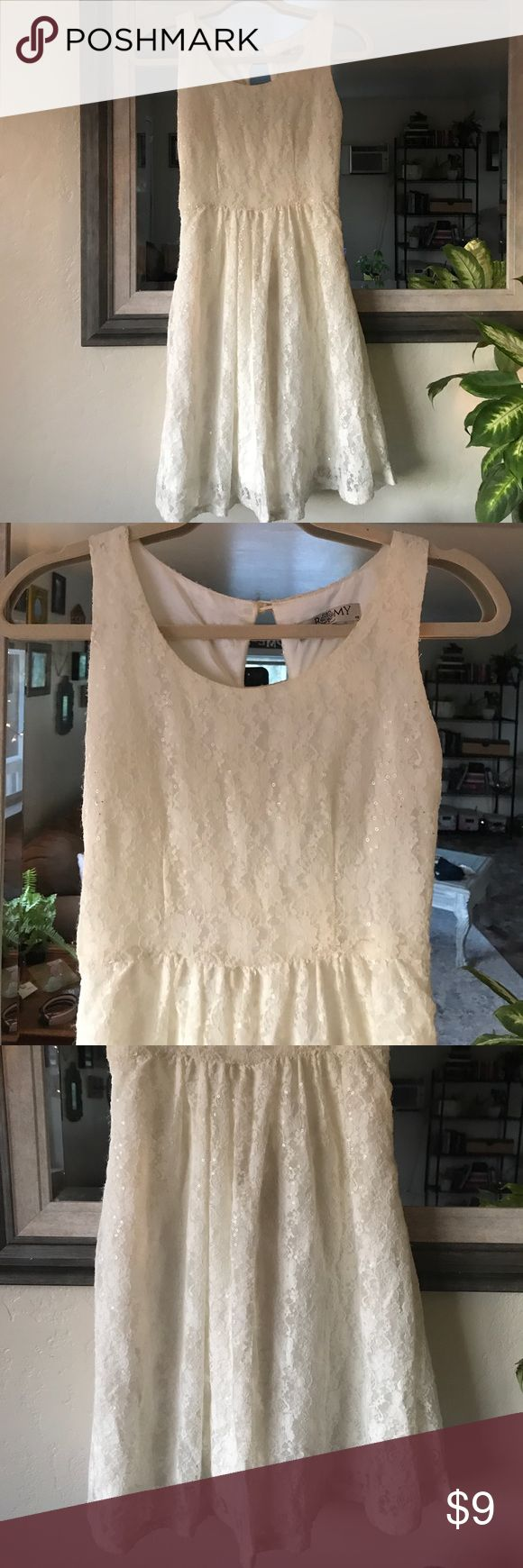 Cream Lace Dress Cream Lace Dress with sequins and side zipper. Slight wear on dress. Romy Dresses Midi