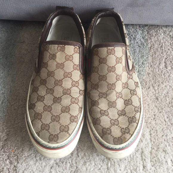 Men's Gucci Slip ons Men's Gucci Slip ons. Wear present and down in pictures. Gucci size 8 fits my husband who wears a 9-9.5 US. Gucci Shoes