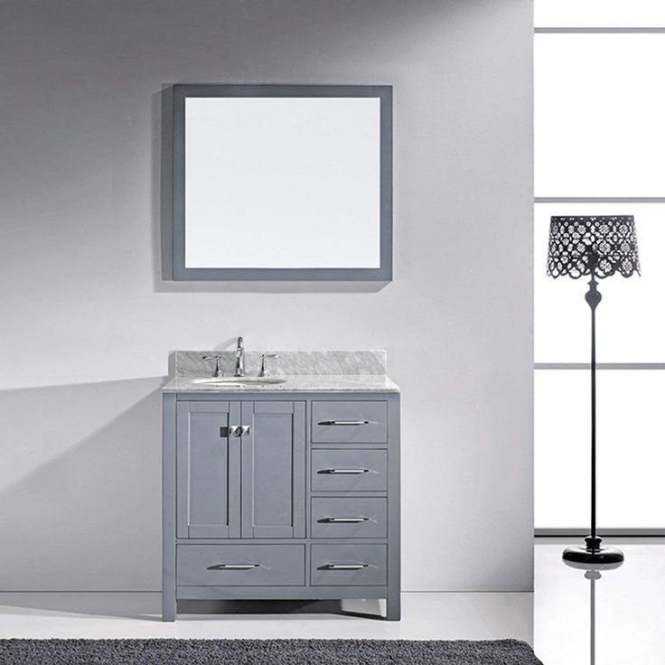 36 inch Virtu USA Caroline Avenue Single Bathroom Vanity with Marble Top and Round Sink with Mirror The Caroline Avenue series is designed with a bold clean style and built with strong, top notch materials including designer brushed nickel hardware. It offers an abundance of storage space and state of the art technology with its soft closing doors and drawers. Featuring a high quality solid oak wood that will last for years to come. With this vanity's Italian Carrara White Marble countertop…
