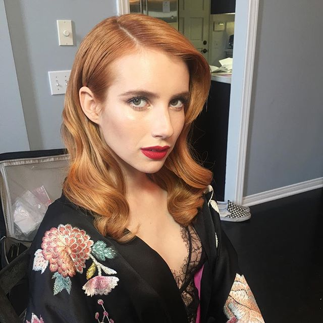 If you've been following Twitter tonight, then you've seen the comparisons of Emma Roberts red hair with Jessica Chastain and TBH they really do look just alike. But, in a good way.
