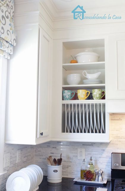 Nix the stacks in favor of an upright rack that makes it easy to grab a dish.   See more at Remondelando la Casa »    - HouseBeautiful.com