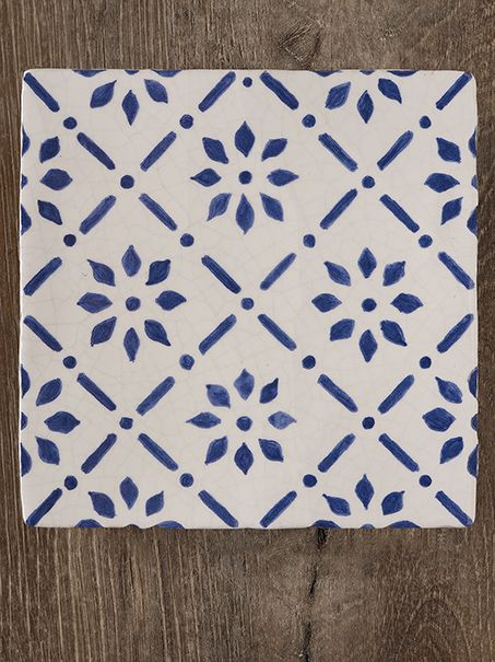 "French Provincial blue and white decorative wall tiles knows no bounds in Monet's kitchen in Giverny, France. Repainting these original motifs from the 18th century, we then hand decorate and kiln fire our wall decoratives on a 5"" x 5"" hand made tile in one of three whites."