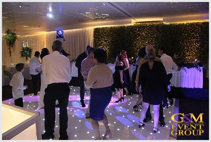 Rainforest inspired wedding reception at the Hilton Gold Coast - Dancing on a  Starlight Dance Floor | Surfers Paradise | #GMEventGroup #MCGlennMackay #DJBenShipway #Uplighting #EventLighting #Monogram #DJFacade #StarlightDanceFloor #RainForestTheme