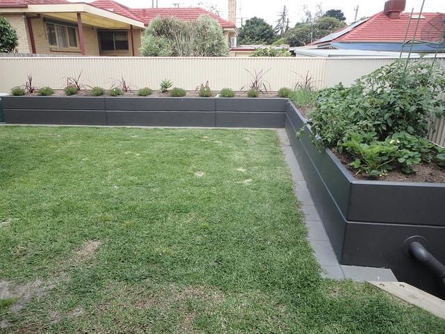 Lovely backyard option: Customer has recently installed five Landscape Tanks along their back fence. Plenty of water and raised garden beds. They propose to grow shrubs to screen out their neighbours in due course. www.landscapetanks.com.au
