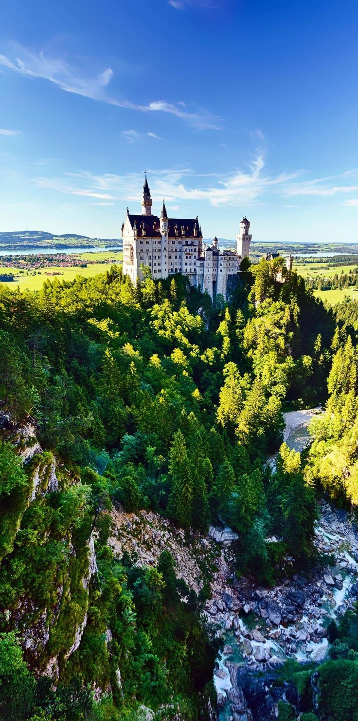 Beautiful Summer View of the Neuschwanstein Castle and the river Poellat running next to it | 10 Most Beautiful Castles in Europe