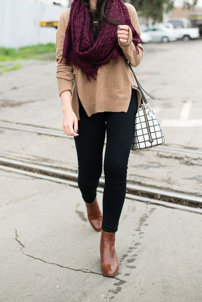 A burgundy scarf is a fall wardrobe staple. Pair it with a cozy sweater and boots on the weekend.