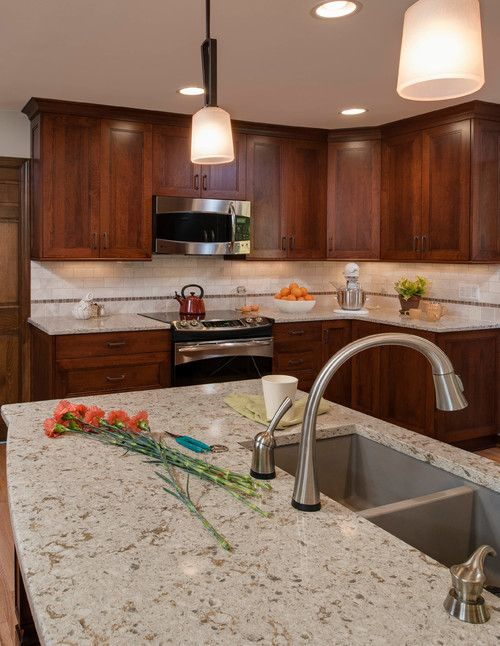 Any tone of dark color cabinets will definitely be compelling to Cambria Windermere Dark Cabinets Backsplash ideas.The backsplash pantone colors are endless