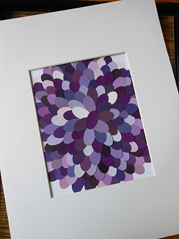 Paint chip art... use an oval punch and either start with a big circle and work in or start in the middle and put the other ones behind on each row, and then frame.