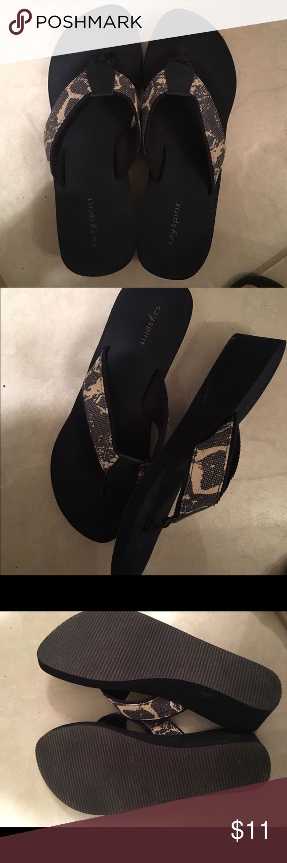 Navy and Beige Wedge Flip Flops Make your outfit cool and walk comfortably with these navy and beige flip flops by easy spirit.  The deign has a touch of gold. Easy Spirit Shoes Sandals