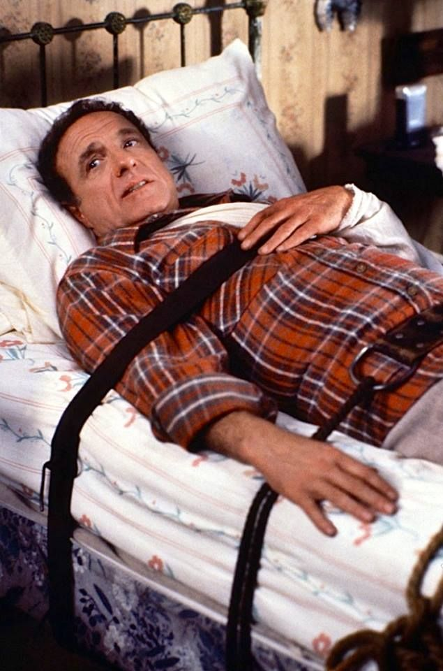 James Caan as Paul Sheldon in Misery a 1990 American thriller film based on Stephen King's 1987 novel and starring Caan, Kathy Bates, Lauren Bacall, Richard Farnsworth, and Frances Sternhagen. Directed by Rob Reiner.